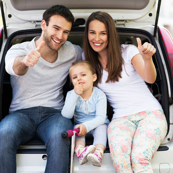 28346240 - family in car showing thumbs up